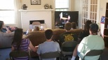 The students gather for regular formation groups, such as this one where they participate in a video Bible study series. Most of the equipment, goods, and services at the ESC--such as the television and access to Netflix--have come from soliciting donations and talking about the importance of college ministry work with Baylor Alumni and members of local churches.