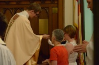 Offering communion at St. Paul's Waco.